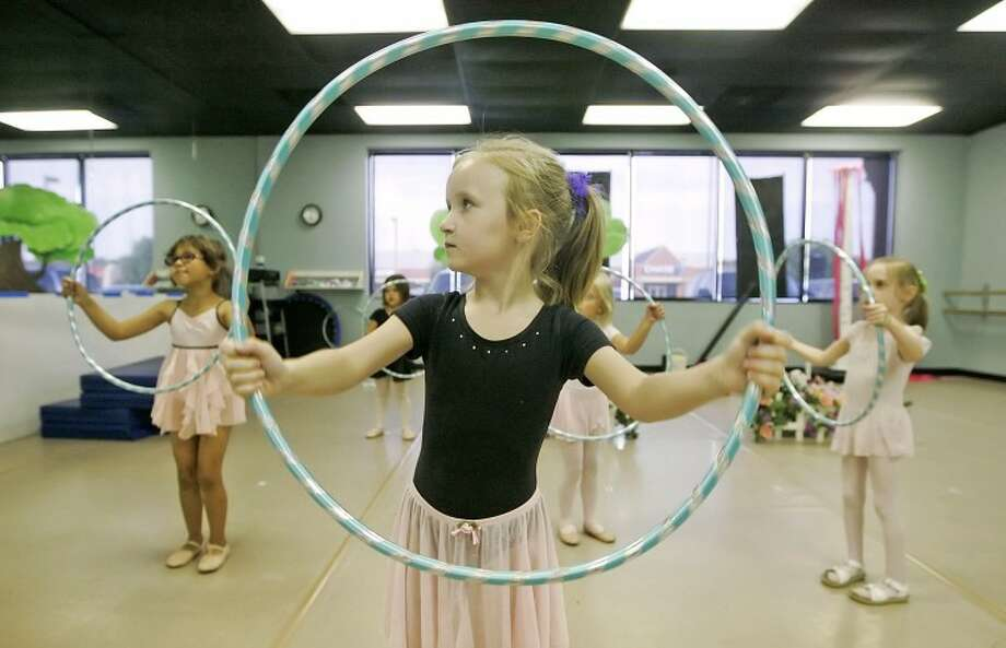Hannah C'ox, 5, works on her hand and eye coordination as she mimics her instructors hula-hoop movements Monday at Art & Soul, a Christian-based dance and fine arts studio. Cindeka Nealy/Reporter-Telegram Photo: Cindeka Nealy