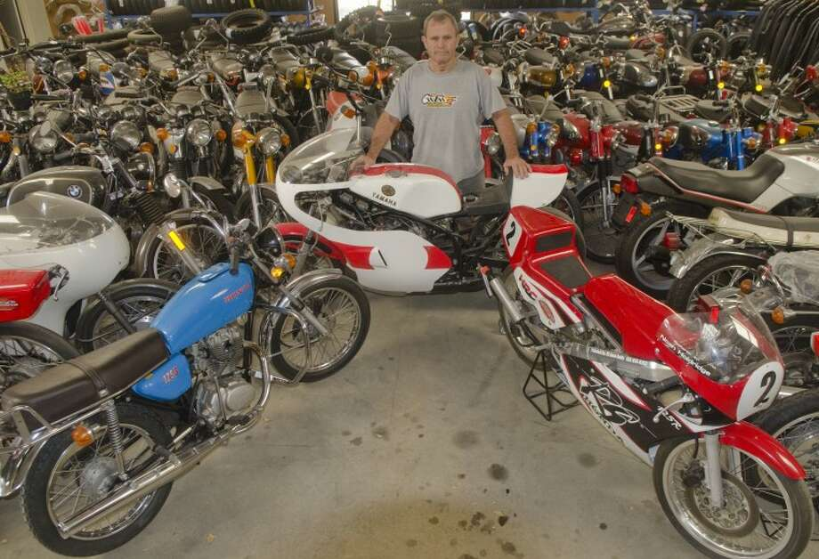 Mike Long, owner of Motorcycle Performance, stands with some of his bikes, including two, in front, his grandsons rebuilt themselves. Photo by Tim Fischer/Midland Reporter-Telegram Photo: Tim Fischer
