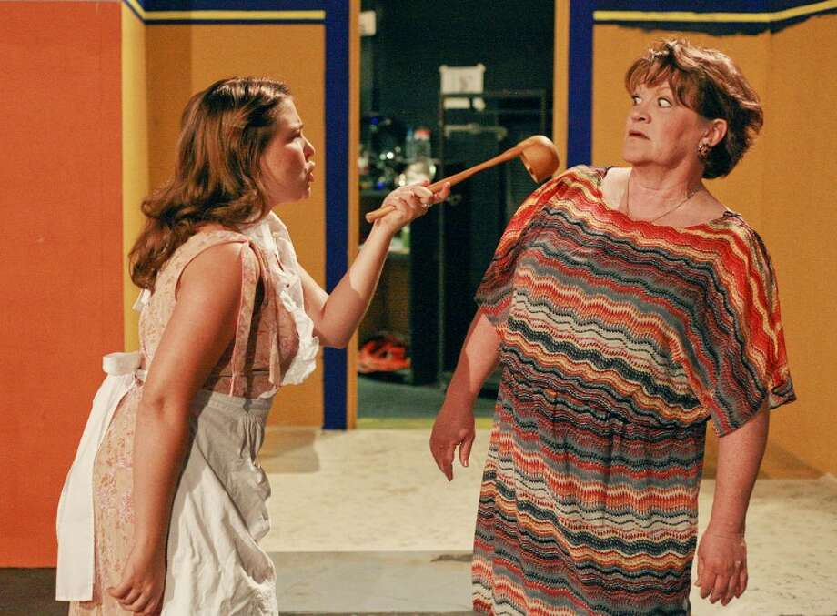 """Florence (Evelyn Armstrong), left, and Olive (Liz Koeninger) argue over the dinner party during rehearsals for the Maverick Players' production of """"The Female Odd Couple"""" at the Cole Theatre. Cindeka Nealy/Reporter-Telegram Photo: Cindeka Nealy"""