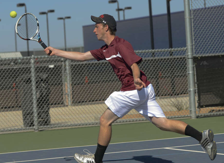 Lee High's Stephen Mangum returns a shot Monday in a match at Bush Tennis Center in the first round of the District 2-5A Tournament. Tim Fischer\Reporter-Telegram Photo: Tim Fischer