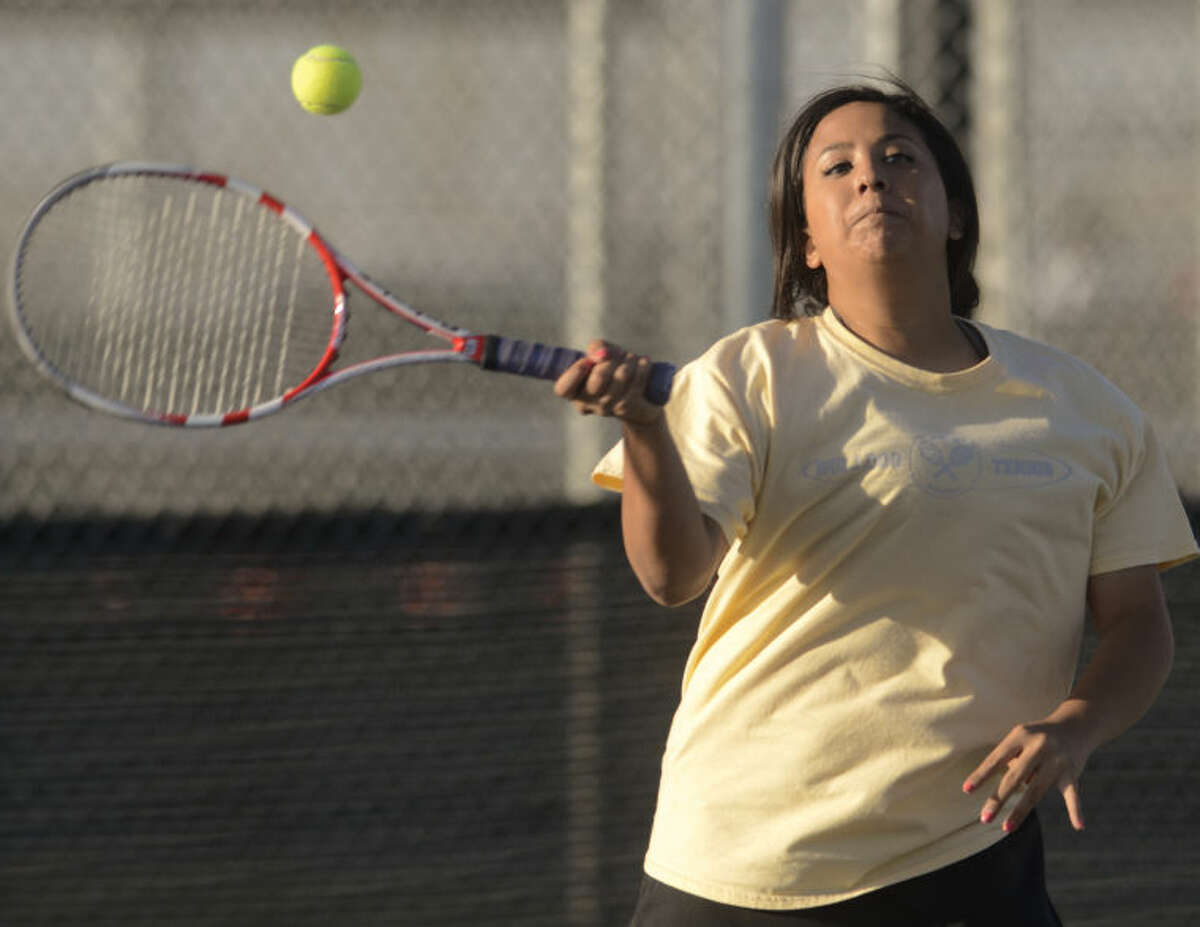 Midland High's Katie Almaguer returns a shot Monday in a match at Bush Tennis Center in the first round of the District 2-5A Tournament. Tim Fischer\Reporter-Telegram