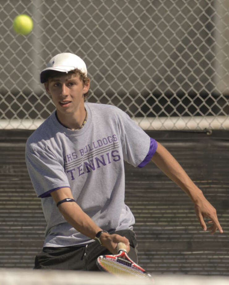 Midland High's Jacob Stump returns a shot Monday in a match at Bush Tennis Center in the first round of the District 2-5A Tournament. Tim Fischer\Reporter-Telegram Photo: Tim Fischer