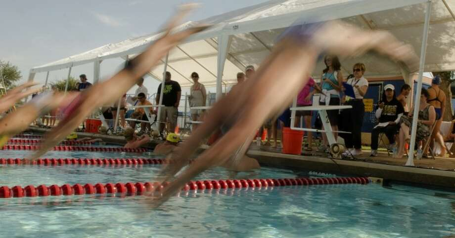 Swimmers at the WNB Invitational take off in the boys 13 and over 200 m butterfly Friday at Doug Russell Pool. Photo by Tim Fischer/Midland Reporter-Telegram Photo: Tim Fischer