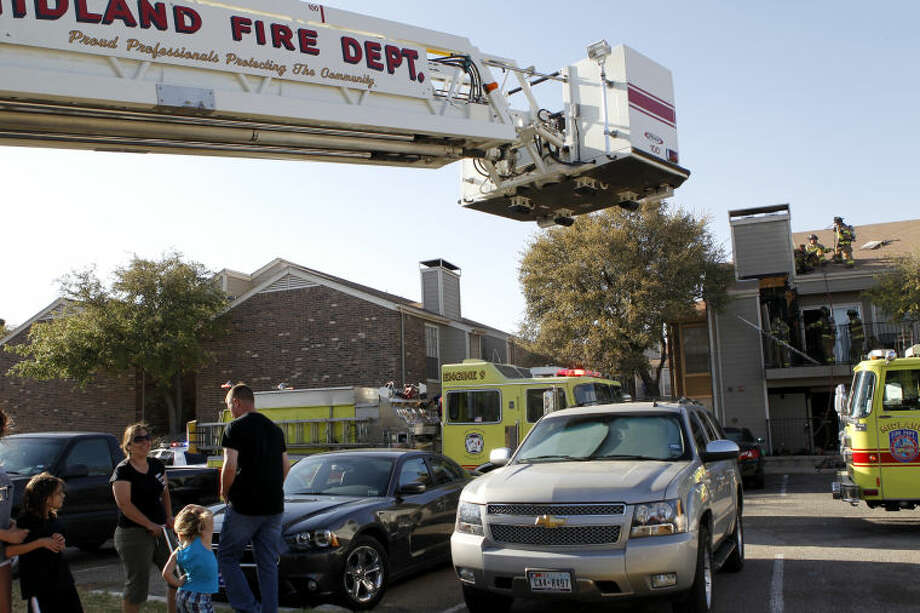 Midland emergency personnel responded to a structure fire Monday at The Dakotas at Saddle Club apartments on North A and Loop 250. James Durbin/Reporter-Telegram Photo: JAMES DURBIN