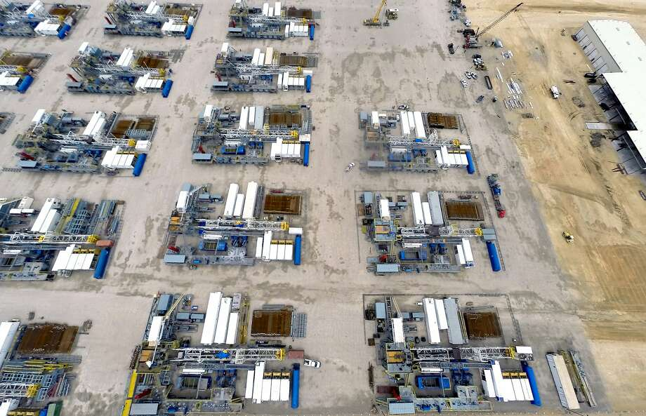 "Idled rigs are seen at a Helmerich & Payne operations center in Seguin. The Texas Petro Index at mid-year showed the ""gut punch"" of the COVID-19 pandemic, with the index showing a plunge in commodity prices, rig count and employment. Photo: William Luther, San Antonio Express-News"