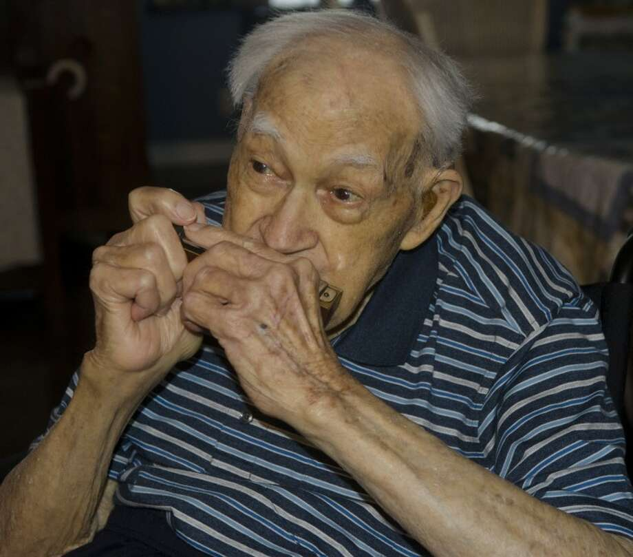 Wilbur Horrell, 95, has been playing a harmonica since he was 8 years old. Horrell will play The National Anthem at the RockHounds game June 20. Photo by Tim Fischer/Midland Reporter-Telegram Photo: Tim Fischer