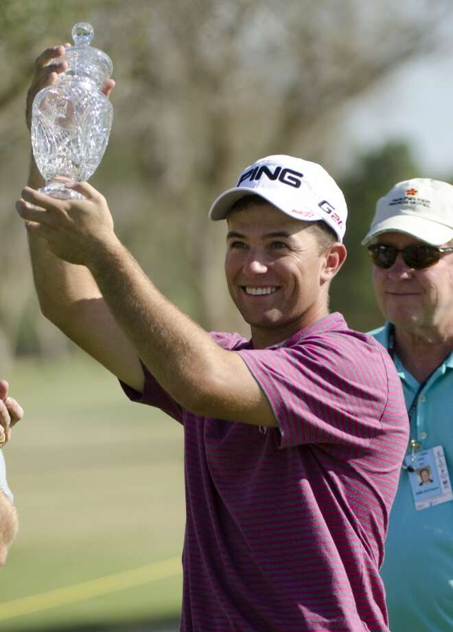 Luke Guthrie holds up the 2012 Trophy for the WNB Golf Classic Sunday afternoon at Midland Country Club. Guthrie won with a final four day score of 271, -17 under par. Tim Fischer/Reporter-Telegram Photo: Tim Fischer