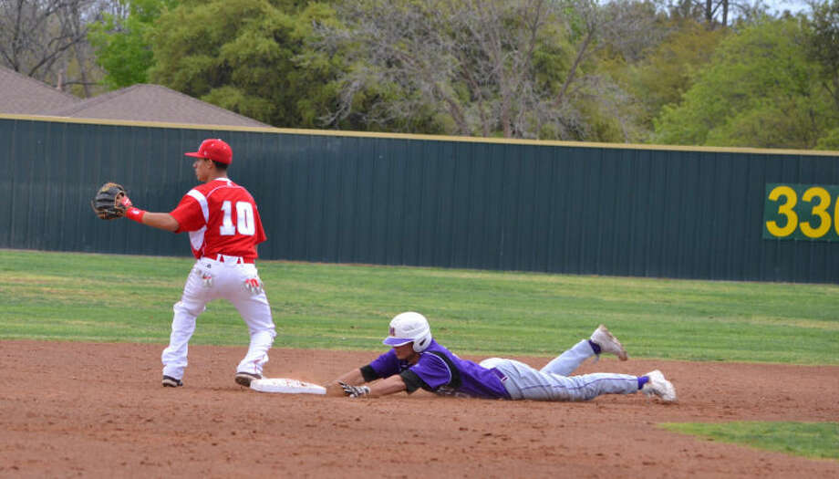 Midland High's Lance White slides safely into second base during the Bulldogs' 7-2 victory against Odessa High on Saturday at Zachery Field. Photo provided by Kim Molina.