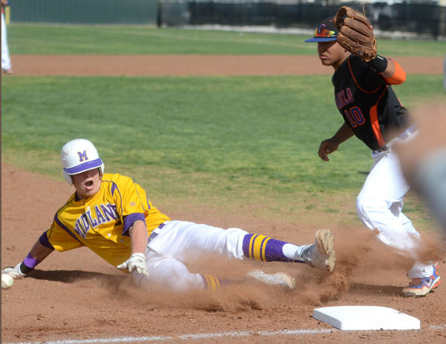 Midland's Jimmy Essman (7) slides into third base as the ball gets away from San Angelo Central's Nick Barron on an overthrow Friday at Zachery Field. Essman was able to score a run before Barron could recover the ball. James Durbin/Reporter-Telegram Photo: JAMES DURBIN