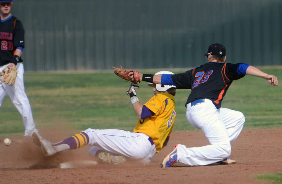 Midland's Brent Stewart slides into second base (5) as the ball gets away from San Angelo Central's Mickey Scott (23) Friday at Zachery Field. James Durbin/Reporter-Telegram Photo: JAMES DURBIN