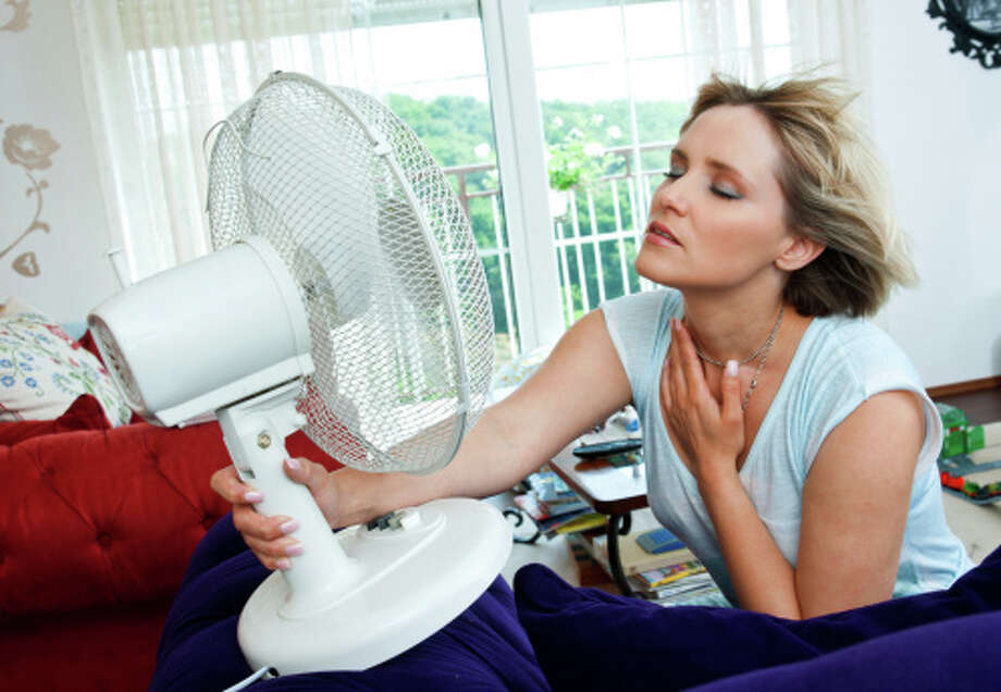 woman cooling herself Photo: Dean Bertoncel / iStockphoto