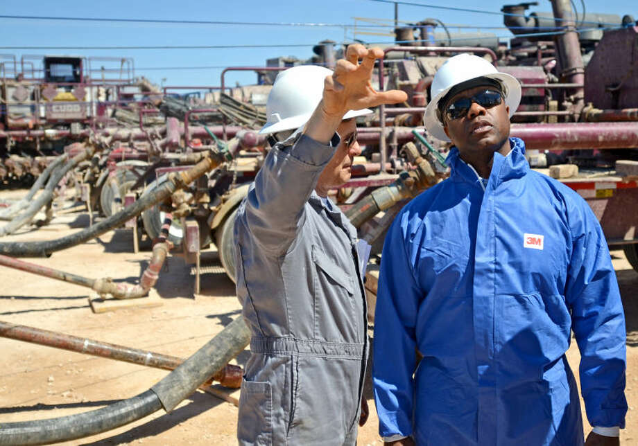 Petroleum engineer Travis White, left, gives a tour to Senator Tim Scott, R-South Carolina, Thursday. James Durbin/Reporter-Telegram Photo: JAMES DURBIN