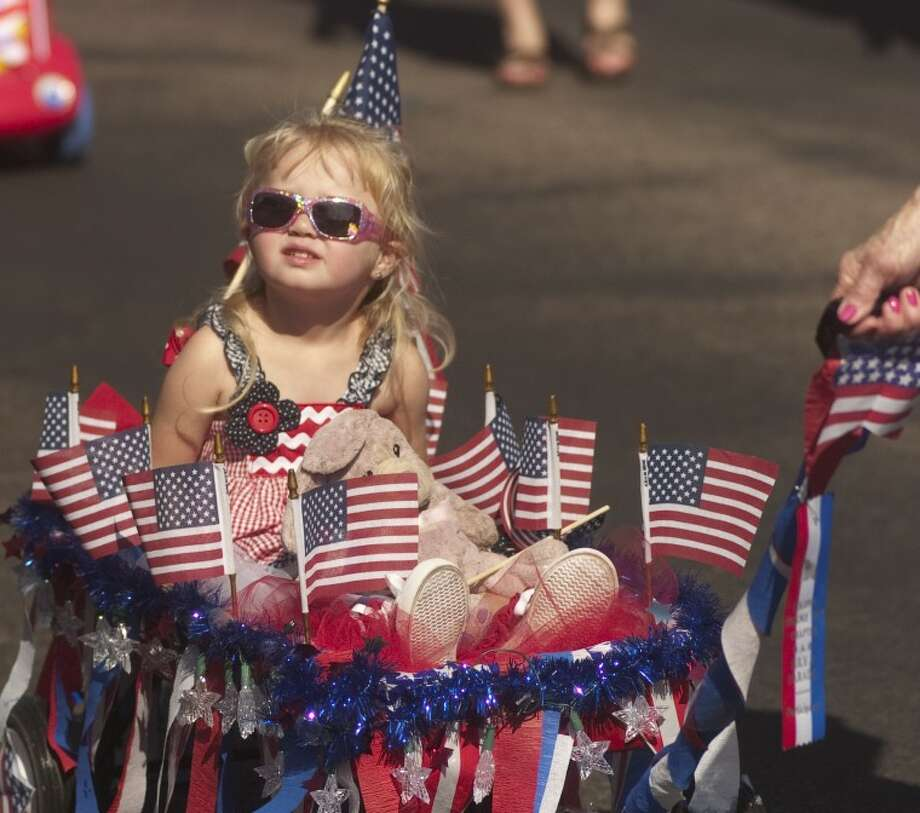 File Photo: Ambree Martinez, 2, is pulled along, decked out in red, white and blue, for the annual Children's Parade July 4, 2011. Photo by Tim Fischer/Midland Reporter-Telegram Photo: Tim Fischer