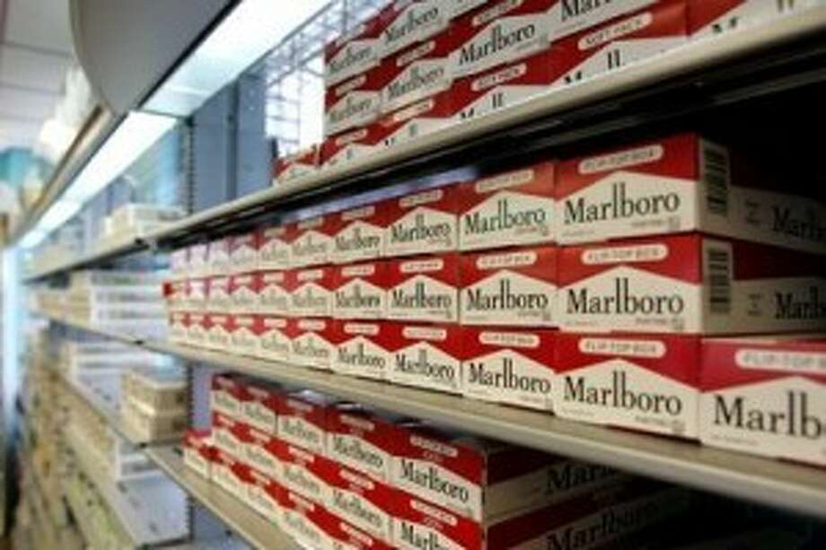 Cigarette cartons line the selves at The Smokers Outlet on Big Spring in this May 2009 file photo.