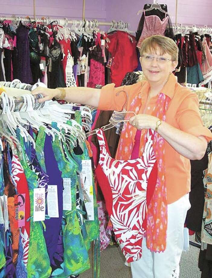 Owner Sharon Wilcox can help you find your perfect swimsuit at The PennyriCh Shop, in Old Town Midland.