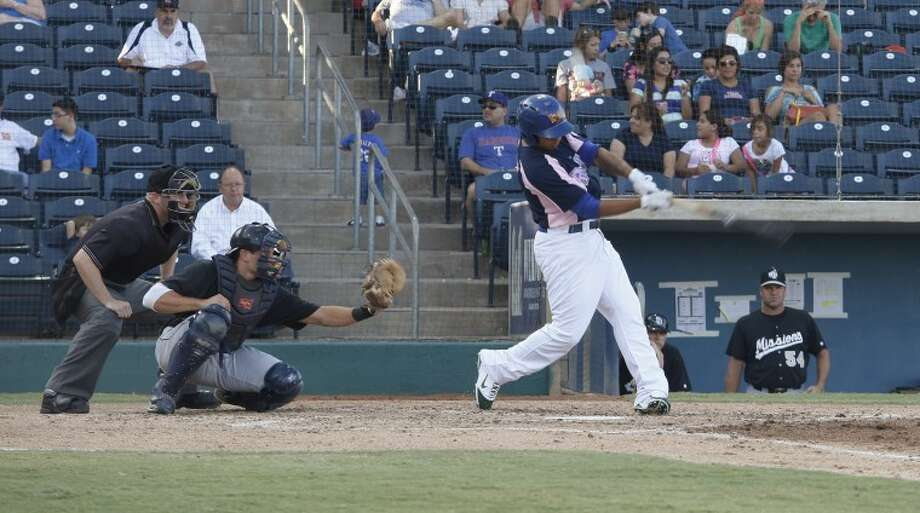 Rockhounds second baseman Tyler Ladendorf swings for a hit during the fourth inning of the game Friday night. Chaney Mitchell/Reporter-Telegram Photo: Chaney Mitchell