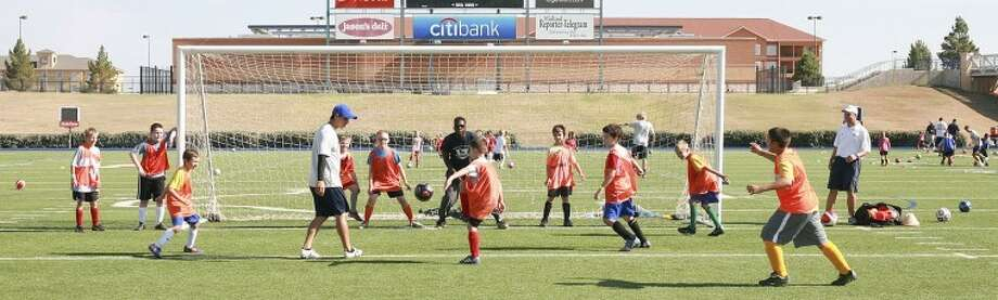 Children participating in the Midland Sockers camp work on offensive and defensive drills Thursday at Grande Communications Stadium. Cindeka Nealy/Reporter-Telegram Photo: Cindeka Nealy