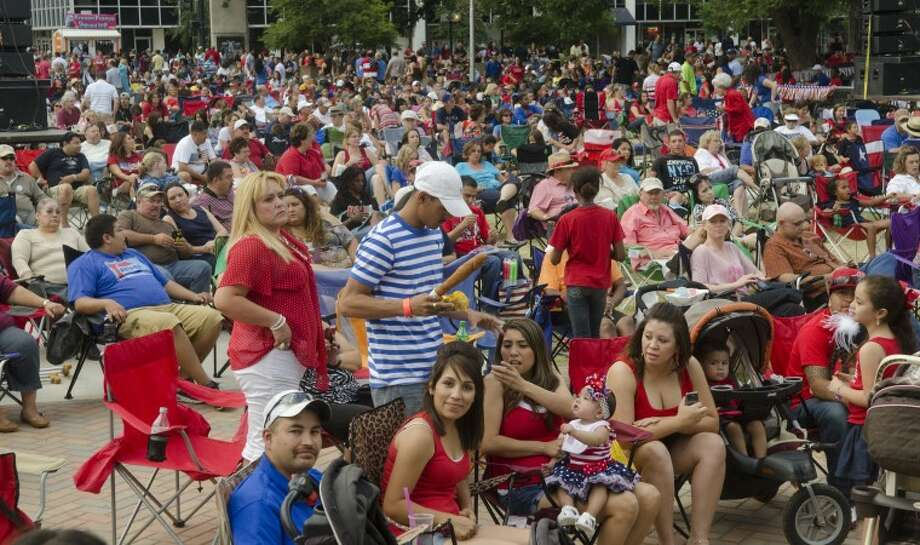 Thousands of area residents fill Centennial Plaza Wednesday evening for a concert followed by fireworks for the Star Spangled Salute. Photo: Tim Fischer/Reporter-Telegram