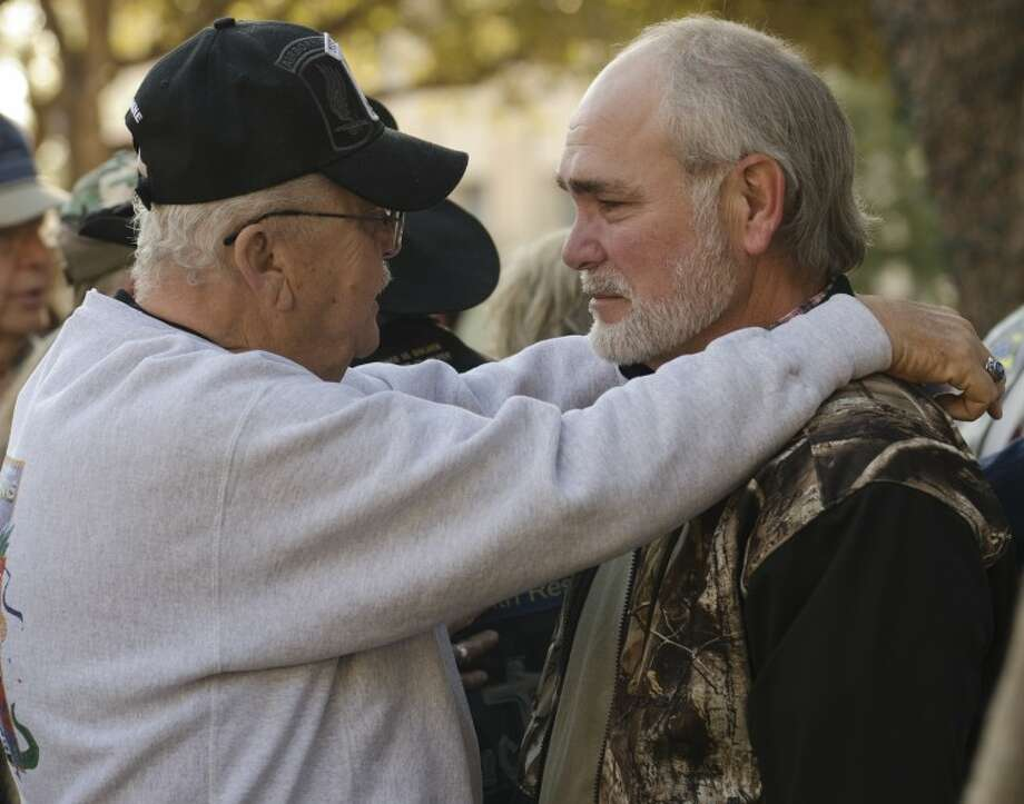 Johnie Lee Qualls comforts and talks with Terry Johnson Friday morning before a community prayer service to pray for all those involved in the veterans parade train accident Thursday. Tim Fischer\Reporter-Telegram Photo: Tim Fischer