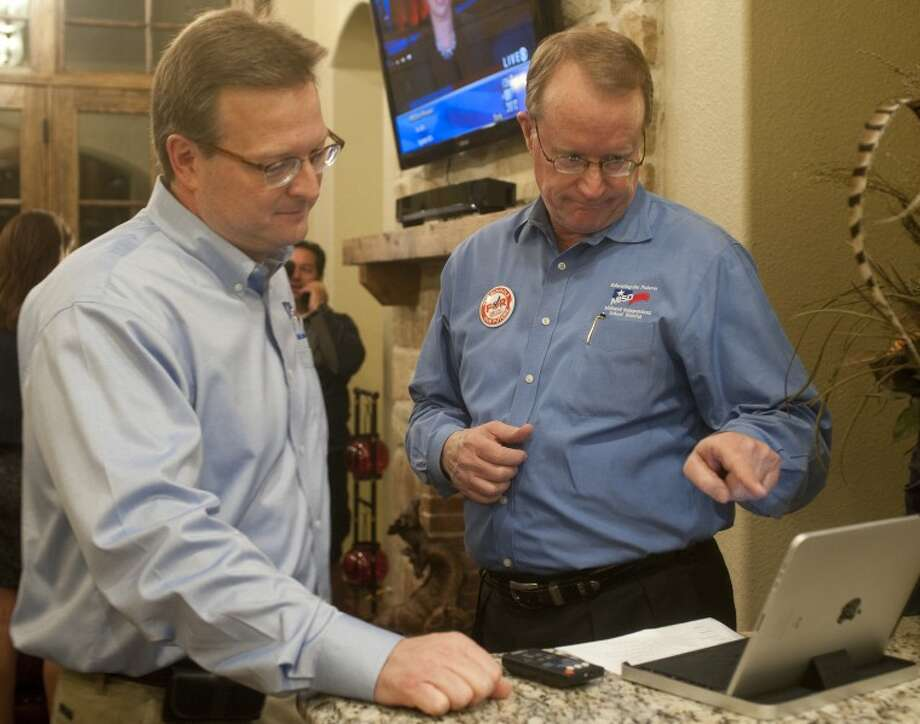 (File Photo) Ryder Warren and Jay Isaacs look over election results Tuesday evening at a bond party. Tim Fischer\Reporter-Telegram Photo: Tim Fischer