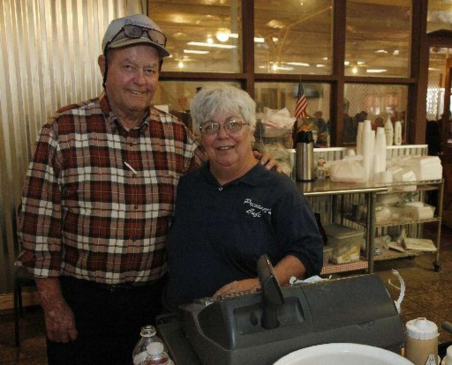Robert and Vonnie Prescott worked the register for the last time Friday, their last day as owners of Prescott's Cafe. Photo: Chaney Mitchell/Reporter-Telegram