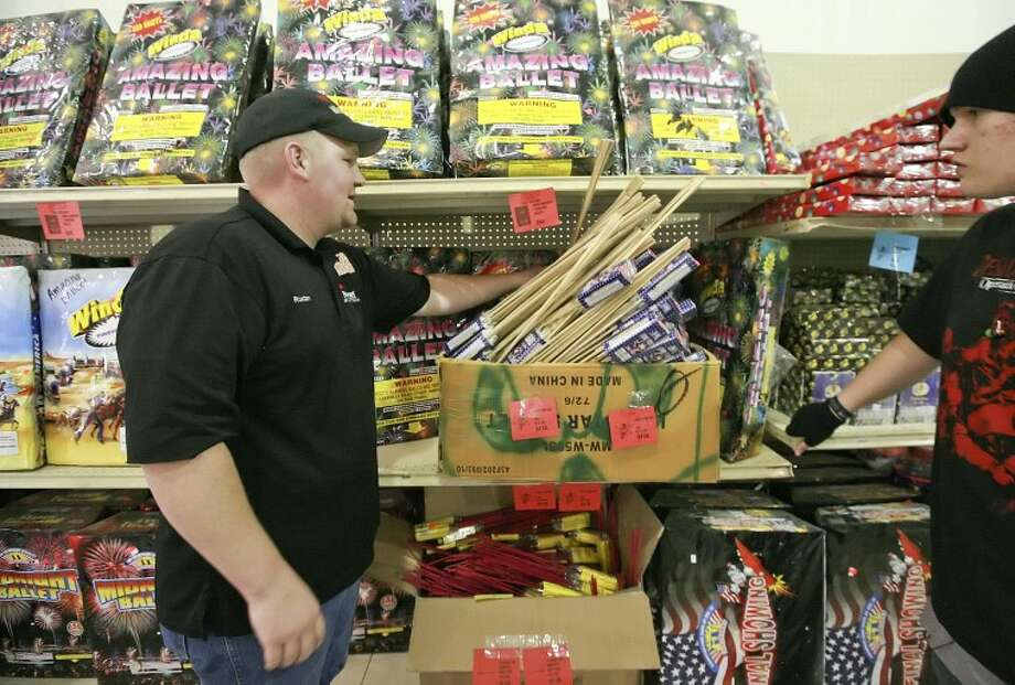 (File Photo) Rustan Foster shows some of the bottle rockets and artillery shells he has for sell at Mr. W Fireworks located on Rankin Highway, south of Interstate 20 in Midland. Cindeka Nealy/Reporter-Telegram Photo: Cindeka Nealy