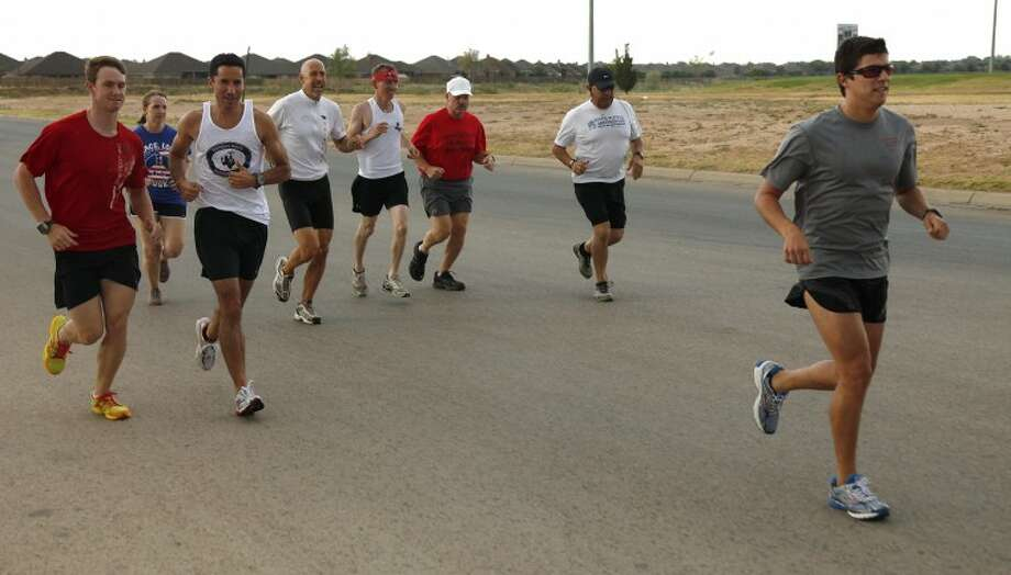 The Permian Basin Running Club sets out from Stonegate Fellowship parking lot Thursday. Some of the members are preparing for marathons. Photo: Chaney Mitchell/Reporter-Telegram