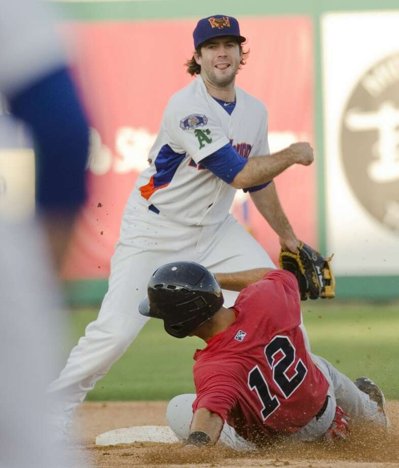 RockHounds' Josh Horton tags second for the force out on Travelers' Jimmy Swift and watches his throw to Anthony Aliotti at first to complete the double play Friday at CitiBank Ballpark. Photo by Tim Fischer\ Reporter-Telegram Photo: Tim Fischer