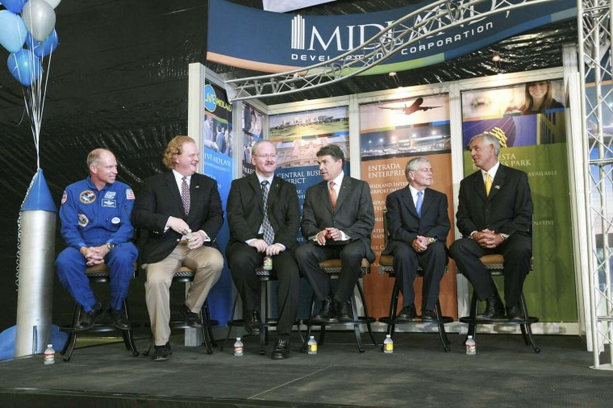 XCOR's Rick Searfoss, director of flight test operations and chief test pilot; from left, Andrew Nelson, chief operating officer; Jeff Greason, president and chief executive officer; Gov. Rick Perry; State Rep.Tom Craddick and Mayor Wes Perry prepare to talk about XCOR Aerospace Inc.'s future in Midland, Monday at Midland International Airport. Cindeka Nealy/Reporter-Telegram