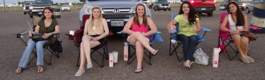 Anna Cain, from left, Henna Kari, Kasey Robey, Jocéli Lima and Sara Agliardi sit outside June 25, at Big Sky Drive In movie theater. Photo: Courtesy Photo