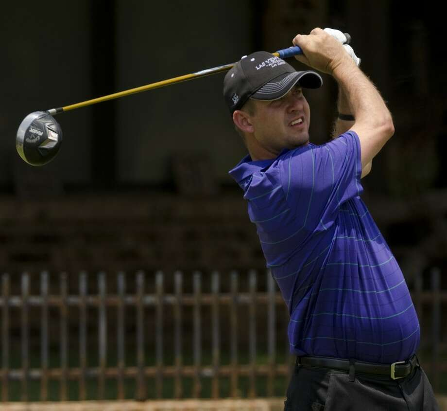 David Bolen follows his shot Friday during the first round of the Green Tree Jamboree at Green Tree Country Club. Bolen won the Jamboree's first glass breaking contest on Friday night. Photo by Tim Fischer\ Reporter-Telegram Photo: Tim Fischer