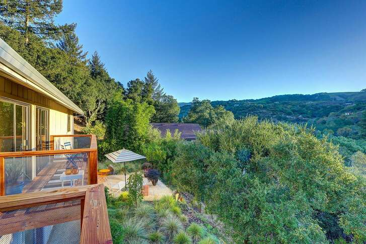 The 2,752-square-foot four bedroom overlooks Wine Country's tree-studded hills.�