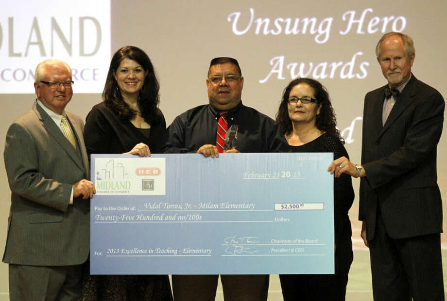 "Event sponsors present Vidal Torres, Jr. with a check for winning the ""2013 Excellence in Teaching - Elementary"" award during an awards banquet Thursday at the Midland Center. James Durbin/Reporter-Telegram Photo: JAMES DURBIN"