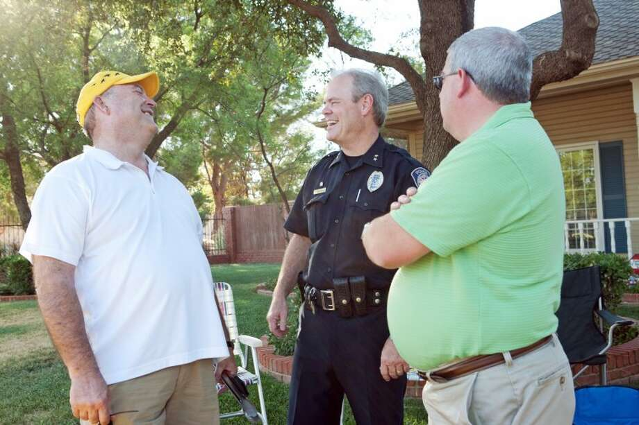 (FILE PHOTO) Joe Coffman, left, talks to Chief Price Robinson and City Manager Courtney Sharp during the city officials' visit to National Night Out block party on the 3600 Block of Woodhaven Drive. Photo: Cindeka Nealy/Reporter-Telegram