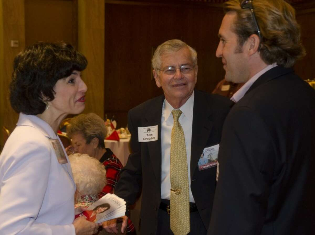 Christi Craddick and her father Tom Craddick talk with Dave Joyner July 18, 2012 before the Midland County Republican Women's luncheon. Photo by Tim Fischer\ Reporter-Telegram