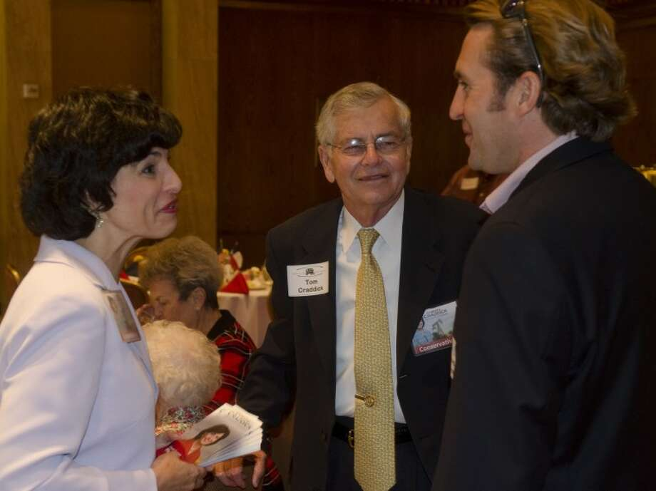Christi Craddick and her father Tom Craddick talk with Dave Joyner July 18, 2012 before the Midland County Republican Women's luncheon. Photo by Tim Fischer\ Reporter-Telegram Photo: Tim Fischer