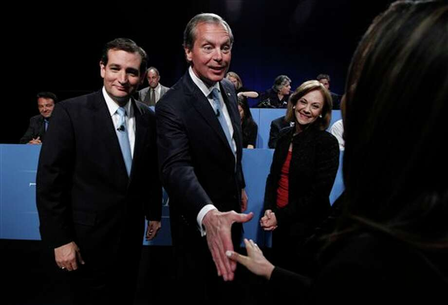 U.S. Senate Candidates Ted Cruz, left, and Texas Lt. Gov. David Dewhurst , center, visit with the panel as moderator Shelley Kofler looks after their televised debate in Dallas, Texas, Friday, June 22, 2012. Cruz and Dewhurst are locked in a runoff fight for the Republican nomination to fill Texas' open U.S. Senate seat. ( AP Photo/Pool/LM Otero) Photo: LM Otero / AP2012