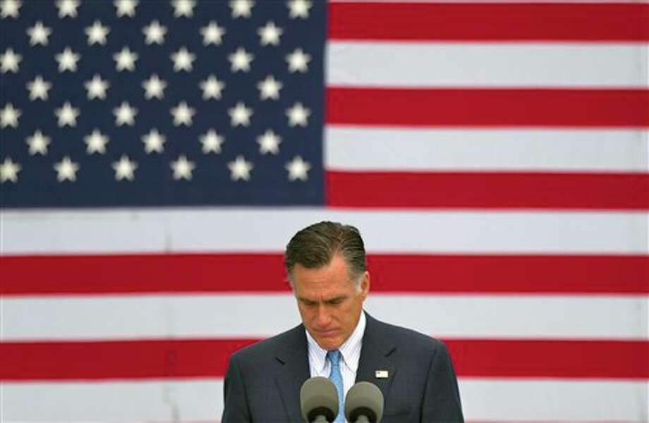 Republican presidential candidate, former Massachusetts Gov. Mitt Romney speaks about the shootings in Colorado at an event in Bow, N.H., Friday, July 20, 2012. (AP Photo/Evan Vucci) Photo: Evan Vucci / AP2012
