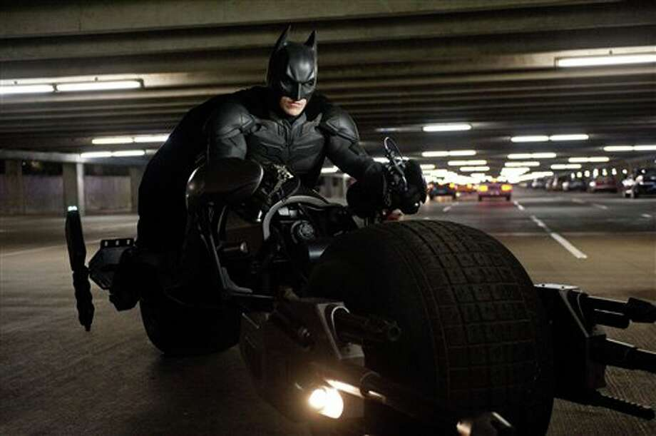"This undated film image released by Warner Bros. Pictures shows Christian Bale as Batman in a scene from the action thriller ""The Dark Knight Rises."" A gunman in a gas mask barged into a crowded Denver-area theater during a midnight premiere of the Batman movie on Friday, July 20, 2012, hurled a gas canister and then opened fire, killing 12 people and injuring at least 50 others in one of the deadliest mass shootings in recent U.S. history. (AP Photo/Warner Bros. Pictures, Ron Phillips) Photo: Ron Phillips / Warner Bros Pictures"