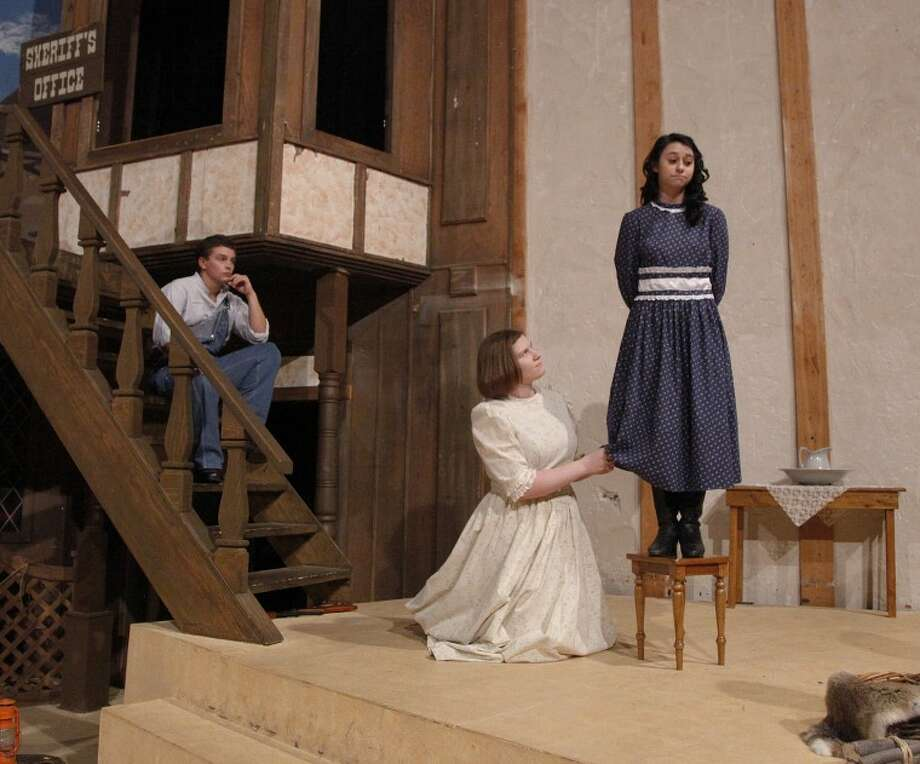 """Cory Maxwell playing Jim Johnson, Victoria Stoner playing Molly and Alexa Nease playing Daisy, perform a scene from """"Whenever It Rains."""" Chaney Mitchell/Reporter-Telegram Photo: Chaney Mitchell"""