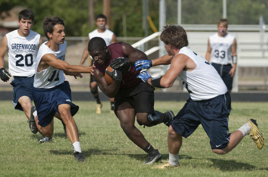 Lee High football players participate in a 7 on 7 touch football game with Greenwood players Monday evening at LHS. Tim Fischer\Reporter-Telegram Photo: Tim Fischer