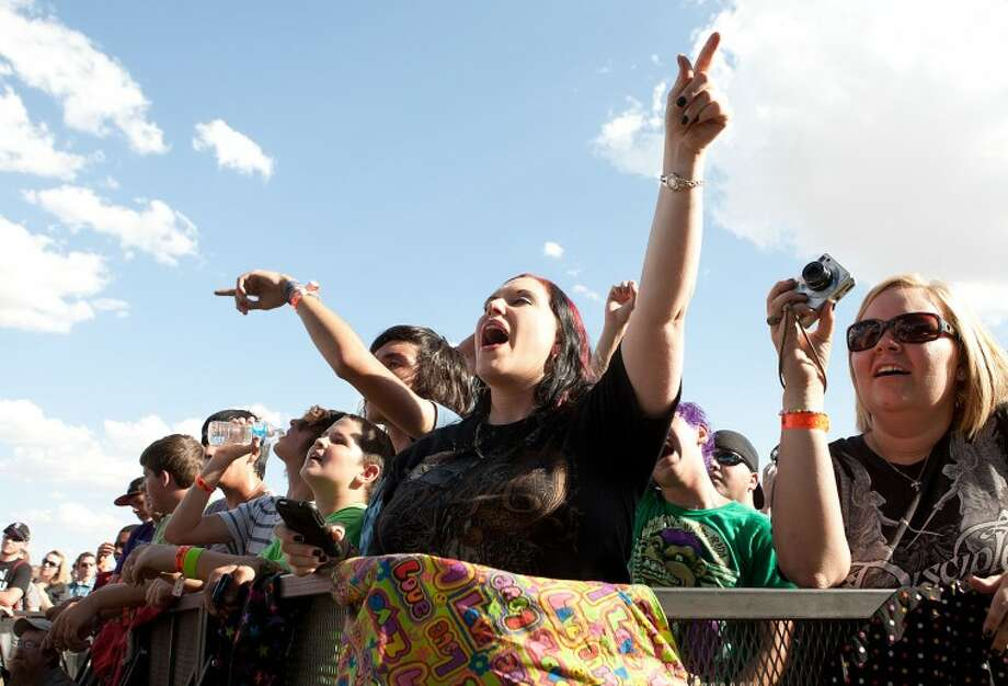 (FILE PHOTO) Cherilyn Amburn throws her hand in the air as she watches Christian heavy metal band Disciple perform during the Spirit in the Sky, Rock the Desert 2011 Christian Music Festival. Cindeka Nealy/Reporter-Telegram Photo: Cindeka Nealy