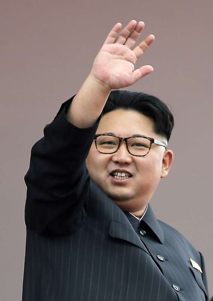 North Korean leader Kim Jong Un waves at parade participants at the Kim Il Sung Square on Tuesday, May 10, 2016, in Pyongyang, North Korea. Hundreds of thousands of North Koreans celebrated the country's newly completed ruling-party congress with a massive civilian parade featuring floats bearing patriotic slogans and marchers with flags and pompoms. (AP Photo/Wong Maye-E)