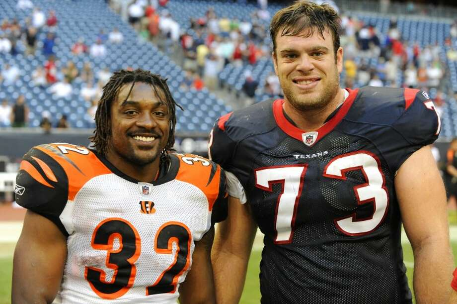 "FILE PHOTO -- Former Lee teammates Cedric Benson (32) and Eric Winston (73) share a smile after battling one another at Houston's Reliant Stadium. Winstons"" Texans came out on top 35-6, but that didn't seem to matter to old friends. Photo: Wade H Clay"