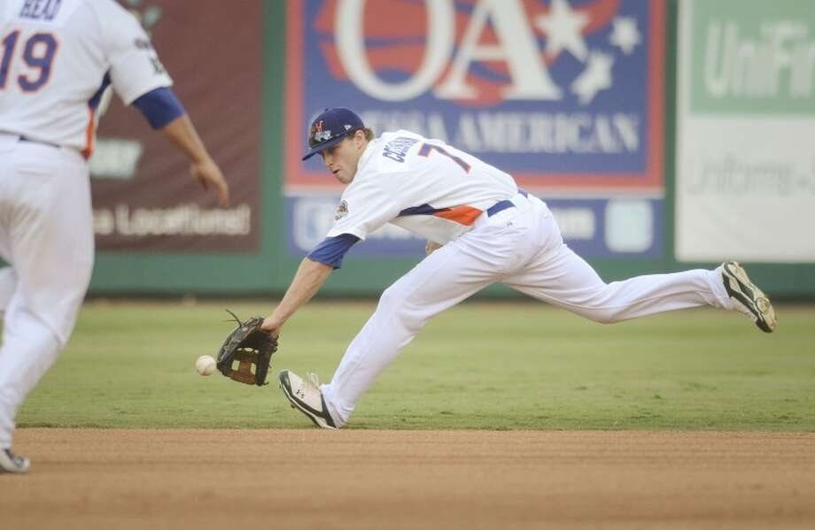 RockHounds shortstop Dusty Coleman reaches to grab a ball hit by Frisco's Ryan Strausborger and tosses the ball to second base to start the 6-4-3 double play earlier this season during their game at Citibank Ballpark. Cindeka Nealy/Reporter-Telegram Photo: Cindeka Nealy