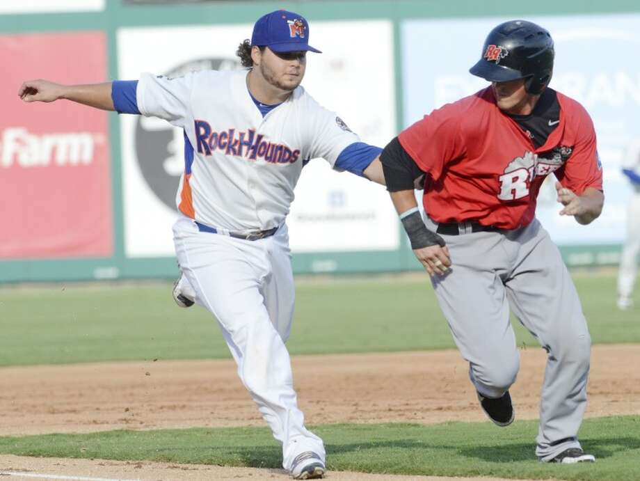 RockHounds third baseman Miles Head tags Frisco's Chris McGuiness out Tuesday during the second inning of their game at Citibank Ballpark. Cindeka Nealy/Reporter-Telegram Photo: Cindeka Nealy