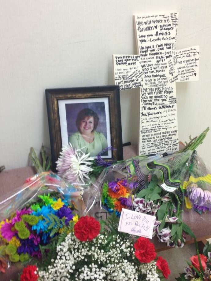 Early College High School @ Midland College students and graduates memorialize Spanish teacher Velma Pando, 54, outside her classroom at Midland College. Pando was killed in a two-vehicle crash Wednesday morning on Northeast Loop 338 and Yukon Road in Odessa after failing to yield to the right of way.