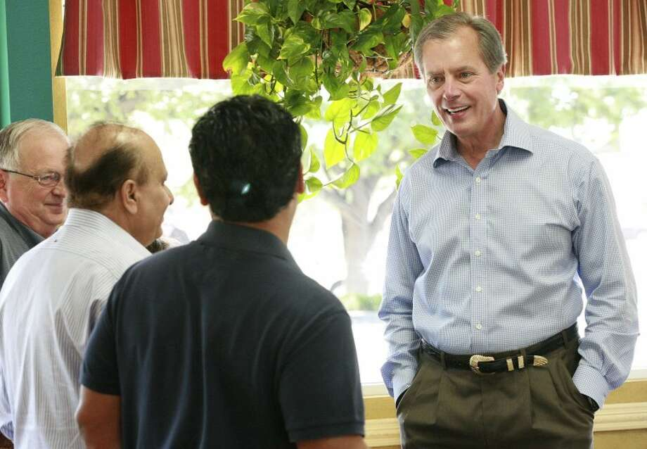 Keith Stretcher, from left, S. Javaid Anwar and Jose Cuevas talk to Lt. Gov. and U.S. Senate hopeful David Dewhurst, Saturday during his campaign stop in Midland. Cindeka Nealy/Reporter-Telegram Photo: Cindeka Nealy
