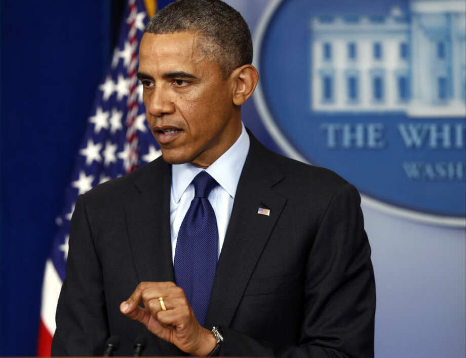 President Barack Obama File Photo Photo: Charles Dharapak