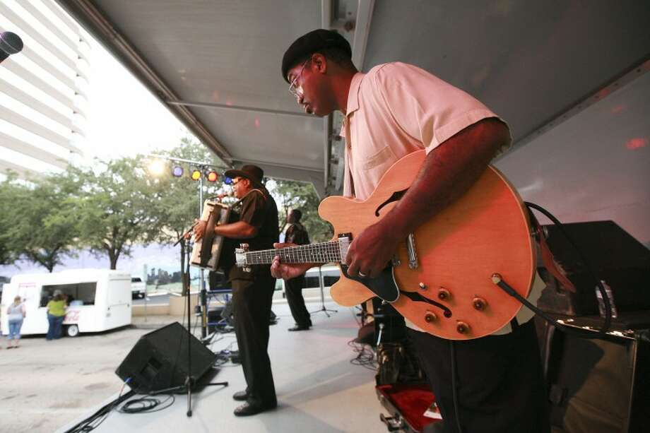 "Zydeco Cha-Cha's lead guitarist Dennis Paul Williams perform ""Every Now and Then"" and ""Every Body Call Me Crazy"" Thursday during opening night for the Tall City Blues Fest in downtown Midland. Cindeka Nealy/Reporter-Telegram Photo: Cindeka Nealy"